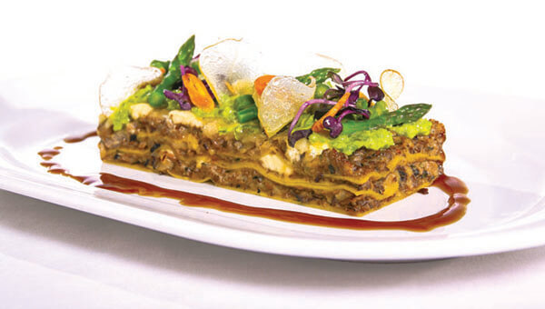 Lasagna dish with garnish