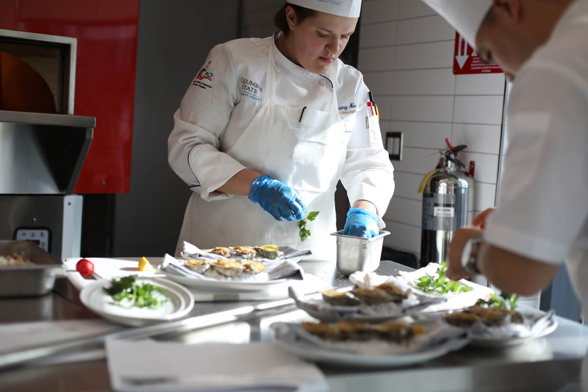 Chef preparing food at Mitchell Hall