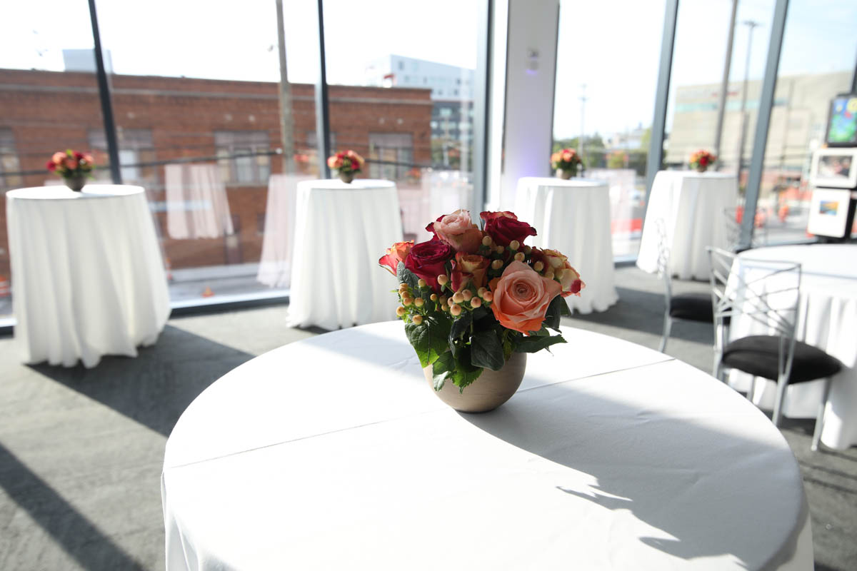 Table inside Mitchell Hall with flower vase centerpiece
