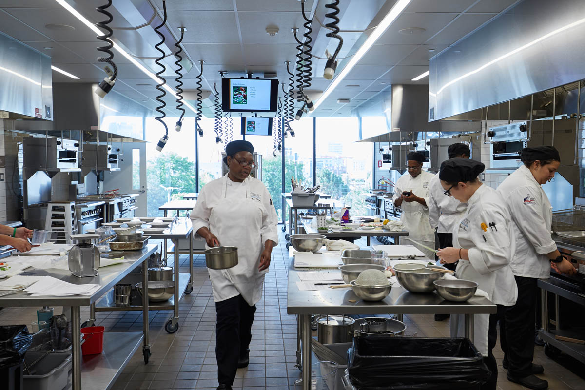 staff inside the kitchen at Mitchell Hall