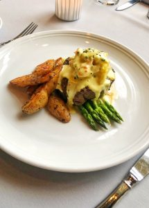 8-ounce Filet Mignon, butter poached Alaskan king crab with asparagus, crispy fingerling potatoes and sous vide bearnaise