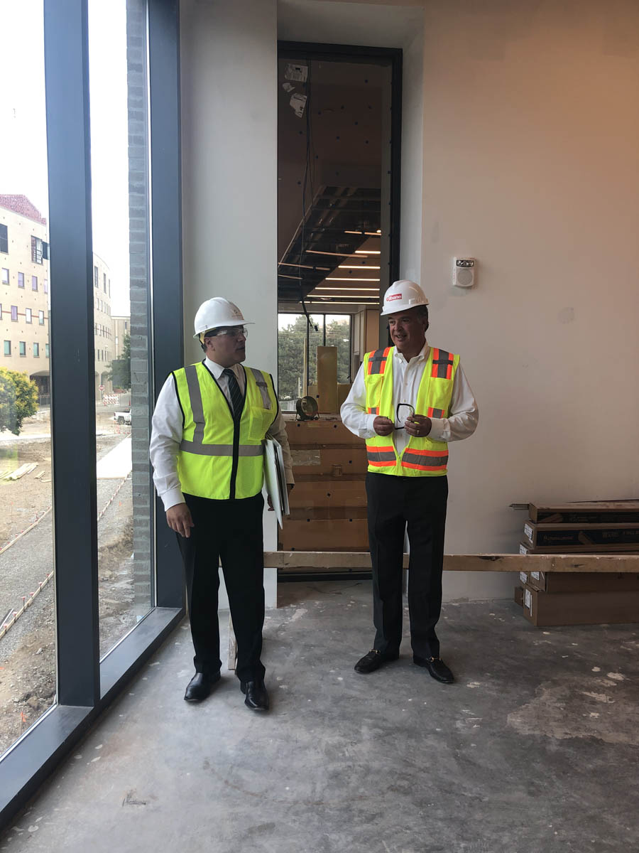 Cameron Mitchell on a tour of Mitchell Hall with construction crew