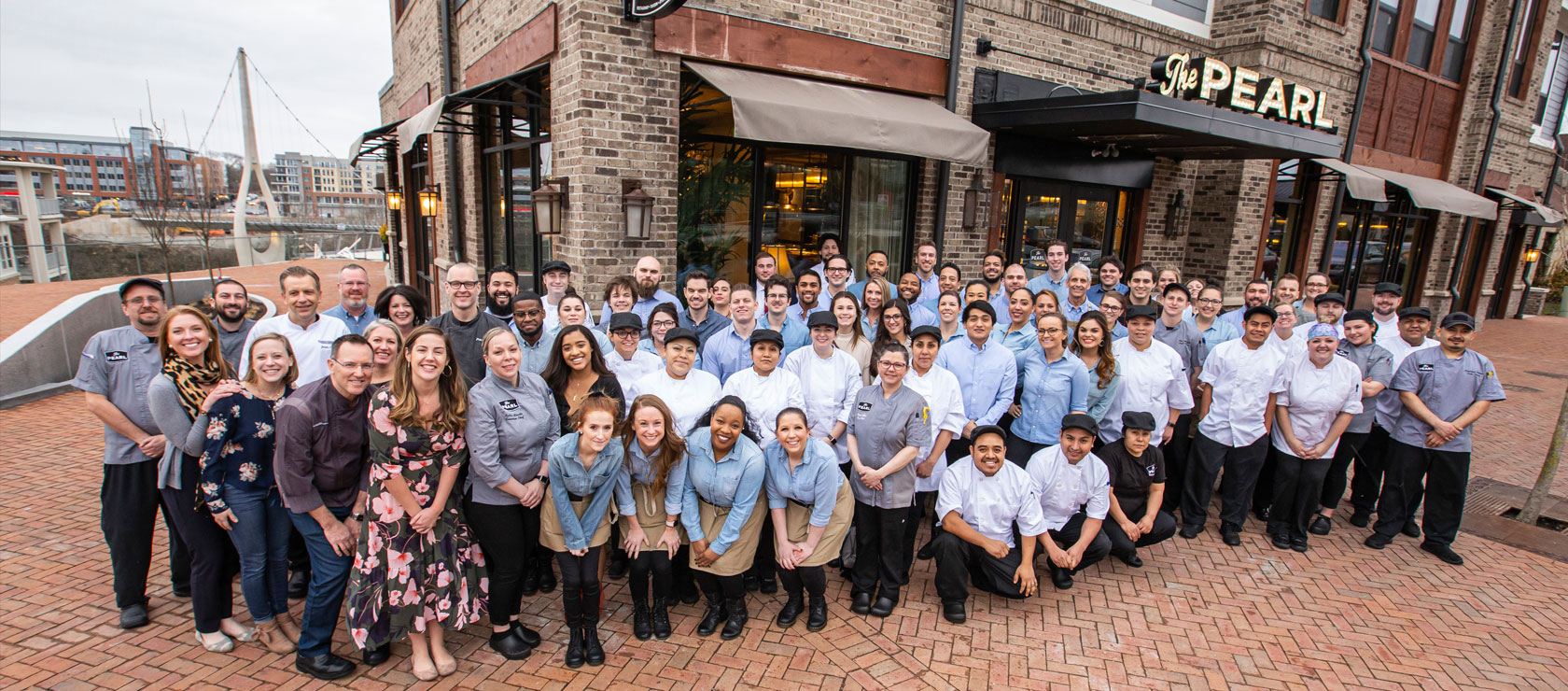Staff posing outside The Pearl Dublin's exterior