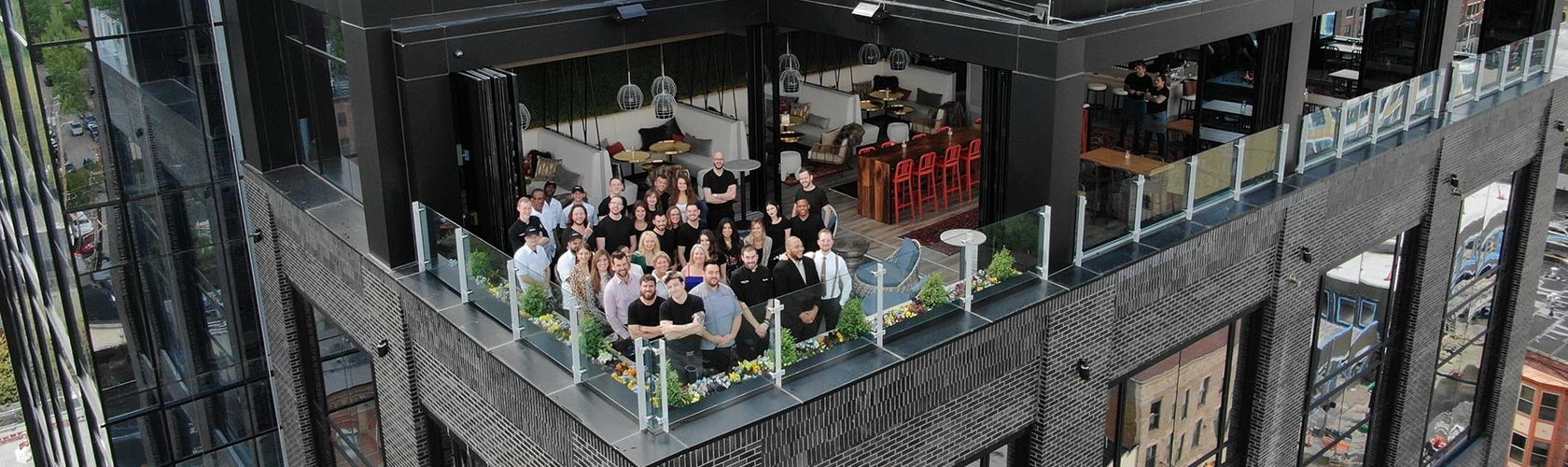 Aerial view of Cameron Mitchell Restaurants associates on the outdoor patio at Lincoln Social.