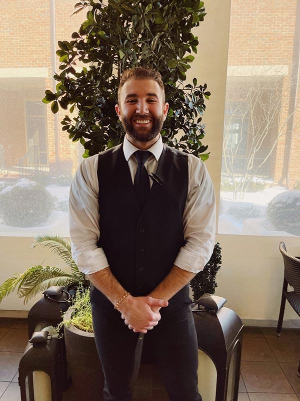 Kurt Vanaman standing inside the lobby of the restaurant.