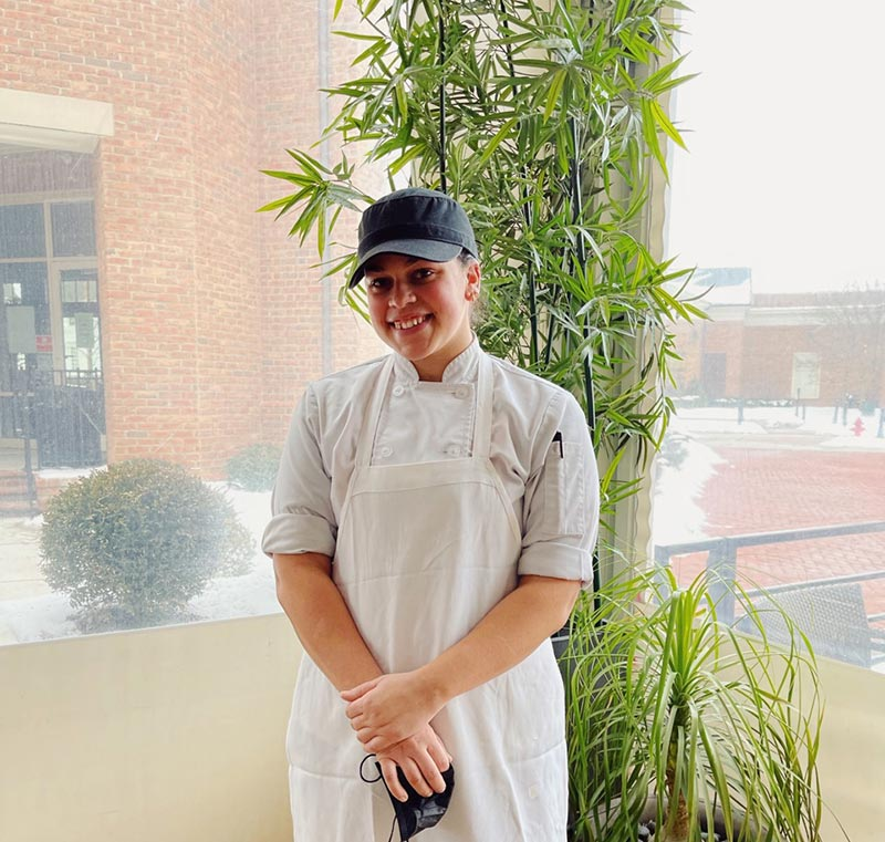 Mya Gonsalves in her work uniform at the Cameron Mitchell Restaurants headquarters.