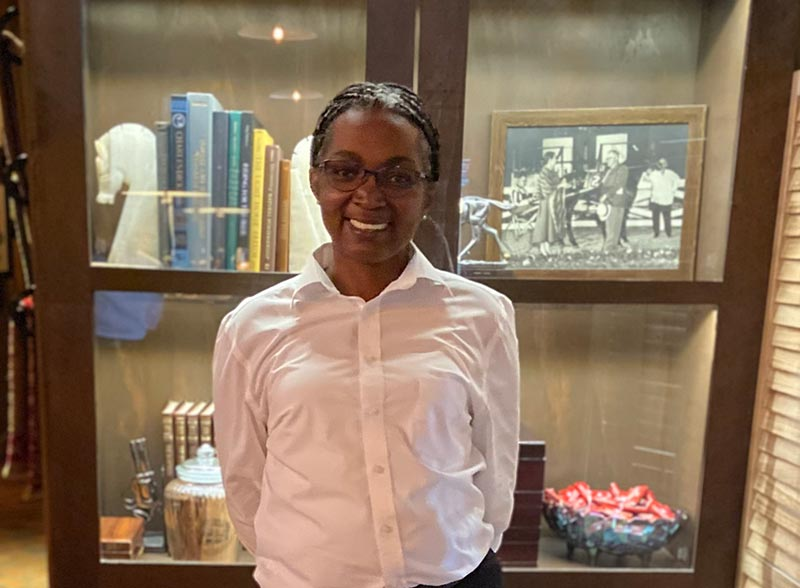 Shenita Wilson standing in front of a display case at The Barn restaurant.