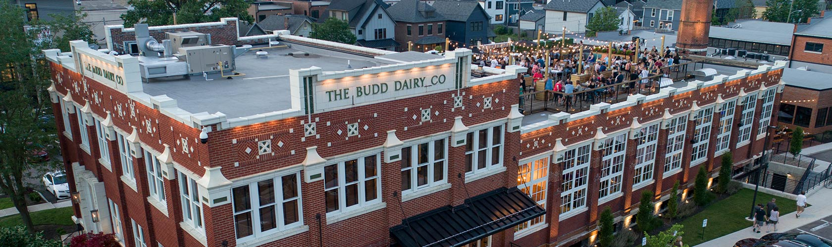 Aerial view of Budd Dairy Food Hall with crowd on roof